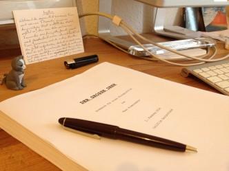 Drehbuch mit Stift